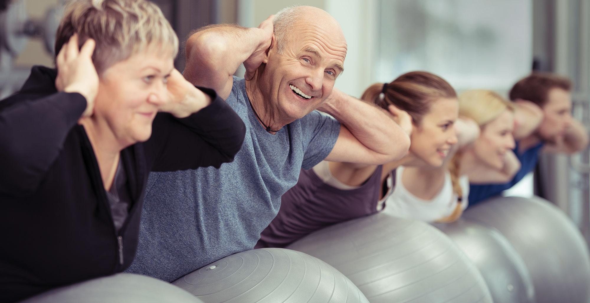 Seniors with exercises balls